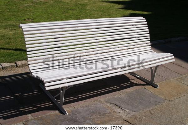 A white park bench.