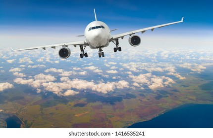 white, passenger airliner fly in sky, take-off of the plane with aircraft's undercarriage, landing gear extension