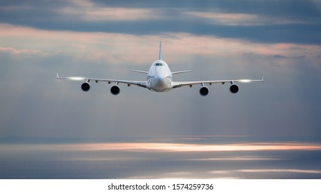 White passenger airplane in the clouds - Travel by air transport