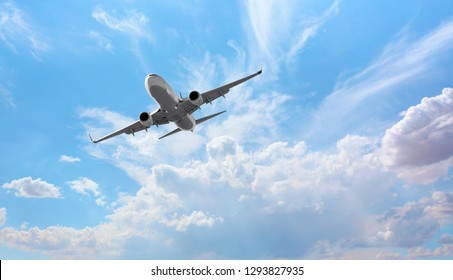 White passenger airplane over the clouds  - Travel by air transport