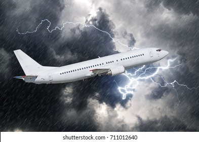 White passenger airplane takes off during a thunderstorm of rain, bad weather