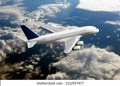 White passenger double decker plane in flight. Aircraft fly high over the clouds.