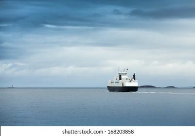 White passenger ferry in overcast weather in Norwegian sea