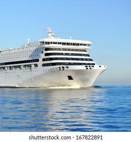 White passenger ferry ship sailing in still water