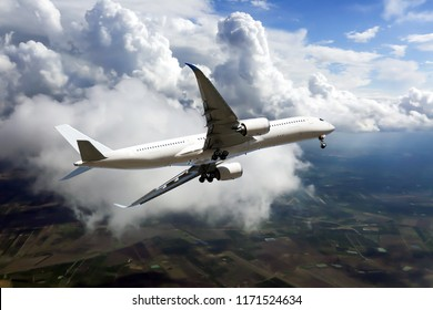 White passenger plane climb above the clouds. Side view of aircraft.