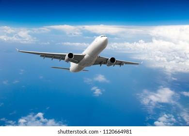 White passenger plane in flight