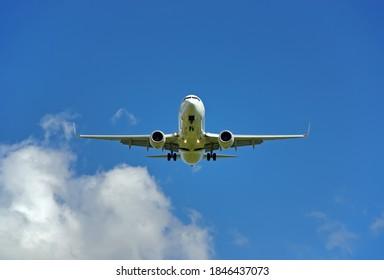 White Passenger Plane landing in the island of Majorca