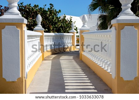 white pastel colored pillars along walkway stock photo edit now