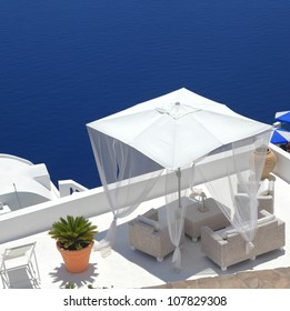 white pavilion in luxurious resort on the cliff of Santorini, Greece