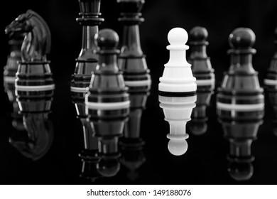 white pawn among black chess