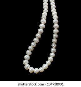 White Pearl Necklace on black background