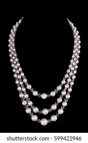 White pearls luxury necklace on black background