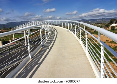 White pedestrian bridge over a highway in Majorca (Spain)