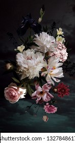 White peonies, roses and other flowers in bloom. Bouquet of beautiful garden flowers on black. Floral decoration. Vintage background. Baroque style.