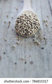 White pepper on wood table.