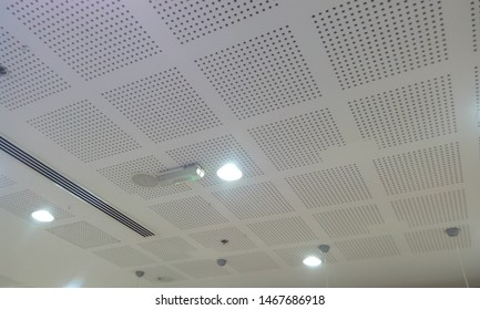 white perforated grid false ceiling