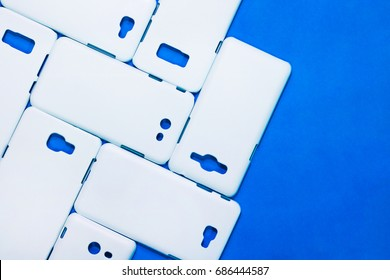White phone cases on vivid blue background. Mobile cases or smartphone protector for your design.