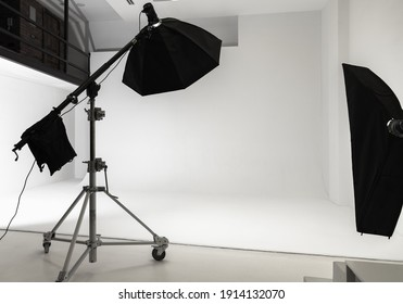 White photo studio interior background, cyclorama structure and professional impulse lights