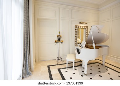 White piano in white room