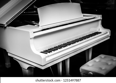 White piano with table and black background