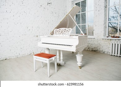 White piano in vintage white room with white brick wall
