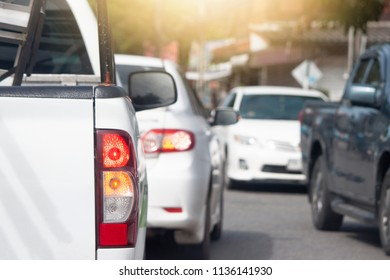 White pick up car on the road go to travel and tourist traffic jam with Parked car