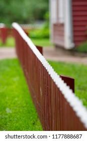White picked fence in garden