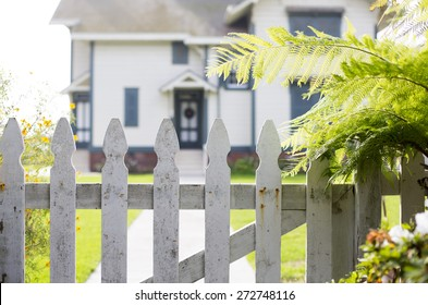 white picket fence and an entrance of a home