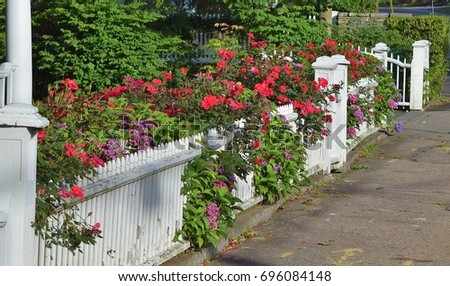 White picket fence flowers stock photo edit now 696084148 white picket fence with flowers mightylinksfo