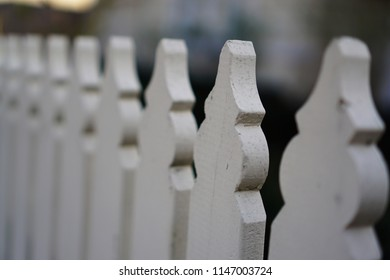 White picket fence in a row signifying same boring average characteristics