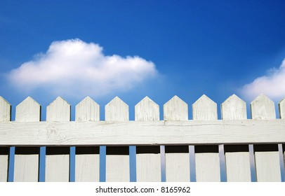 White picket fence and sky