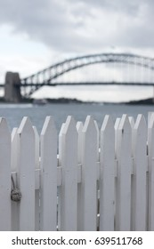 White picket fence with Sydney Harbour Bridge in the background