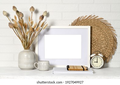 White picture frame with home items