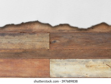 White piece of paper on brown wood with empty text space