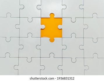 white pieces of jigsaw puzzle and 1 piece orange