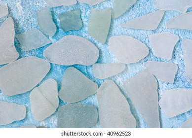 white pieces of sea glass on blue background