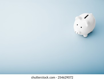 white piggy bank on a blue background