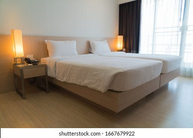 White pillow on bed in bedroom. Relax of white bedroom in home.