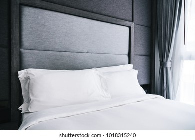 White pillow on the bed decoration in bedroom interior