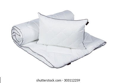 White pillow on blanket isolated