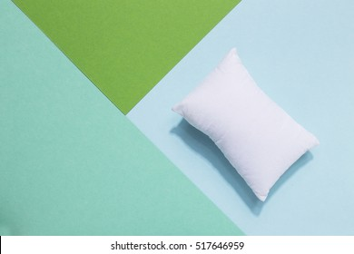 White pillow on colorful stylish background. Going to bed,