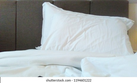 White pillows on the bed.