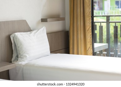 White pillows on a bed Comfortable soft pillows by natural light from with window