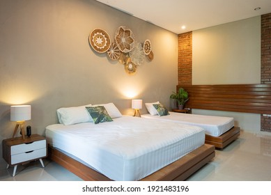 White pillows on bed in simple bedroom interior