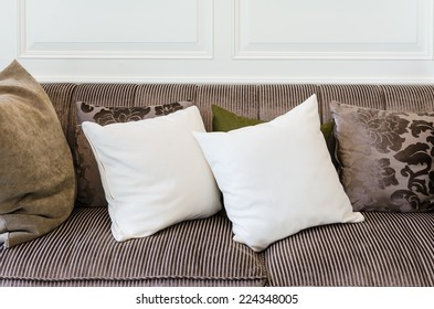 white pillows on  brown sofa at home
