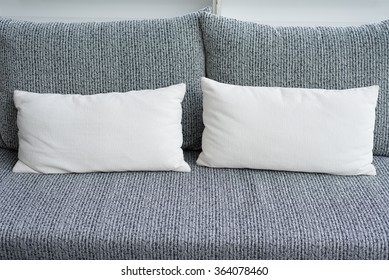 white pillows on grey sofa
