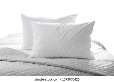 White pillows and sheet on a bed with bedspread isolated on white background