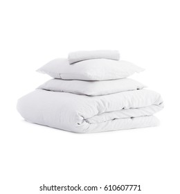 White Pillows and Soft Blanket Isolated on White Background. Bed Linen