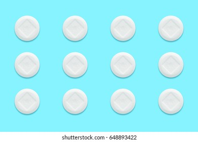 white pills with drop shadow on blue background, vintage tone