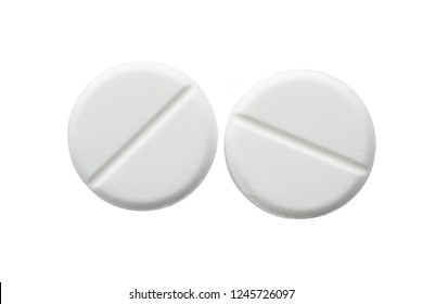 White pills isolated on white background